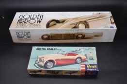 A boxed Schylling Golden Arrow racing car along with a Revell Austin Healey model kit. H.10 W.54 D.