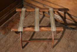A folding luggage stand. H.50 W.57 D.36cm
