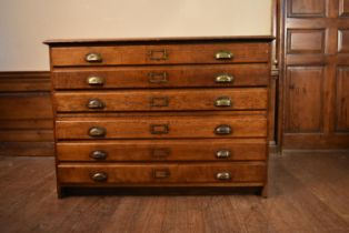 A C.1900 oak two section six drawer plan chest with brass cup handles. H.85 W.120 D.85cm