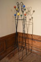A mid century retro vintage metal floor standing coat stand with multi coloured atomic style coat