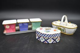 A Continental porcelain hand gilded and decorated lidded caddy, a twin lidded Spode basket and a set