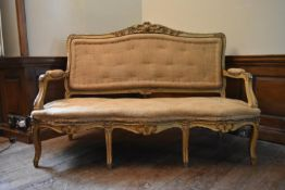 A 19th century French three seater canape with carved gilt and painted framed raised on cabriole