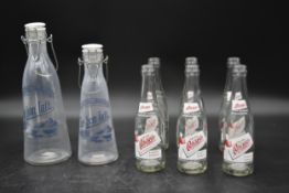 Two vintage milk bottles with stoppers marked; Le bon lait along with six vintage Oscar's