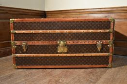 A C.1900 Louis Vuitton canvas monogrammed travelling wardrobe cabin trunk with original maker's
