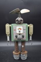 A metal robot sculpture made from vintage electrical components. H.49 W.26cm