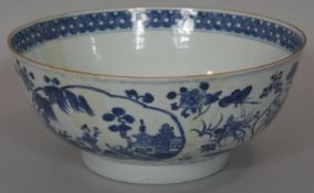 A blue and white 18th century Chinese style porcelain bowl with unglazed foot and oval panels