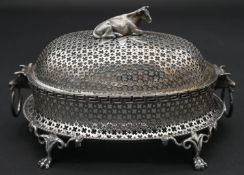 A late 19th century silver plated pierced and lidded butter dish with glass liner and cow shaped