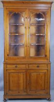 A 19th century style pitch pine two section dresser with glazed upper section above drawers and