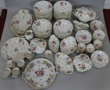 An extensive Royal Vienna hand painted floral design gilded porcelain dinner service, includes 36