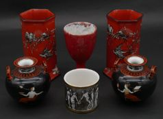 A pair of Arcadian ware red glaze hexagonal vases decorated with birds, along with a pair of Grecian