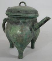 A Chinese bronze archaistic ritual pouring vessel, with character mark to the base. H.23cm
