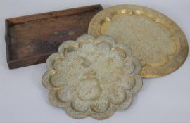 A shaped and engraved Benares tray along with a similar example and a carved Eastern hardwood