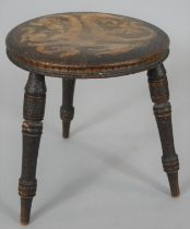 A late 19th century pokerwork stool with dragon decoration. H.32cm