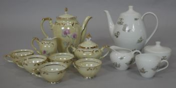Two vintage coffee sets. One German with ship design, one person set, the other pale yellow lustre
