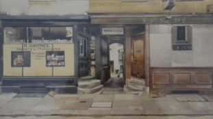 Phyllis Dimond- A framed and glazed print of a shop front, printed signature. H.32 W.41.5cm