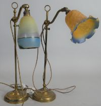 A vintage brass fully adjustable desk lamp with glass shade along with a similar example. H.55cm