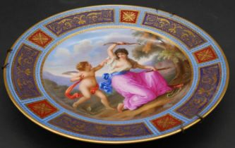 A 19th century porcelain plate hand decorated with scenes from Venus and Amor, Royal Vienna mark
