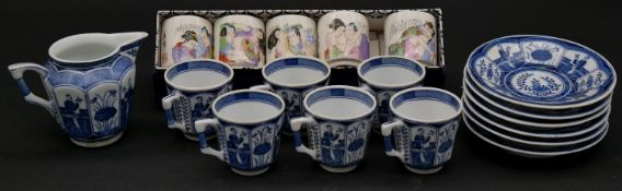 A Chinese blue and white six coffee cups and saucers with jug, decorated with flowers and people,
