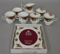 Six Royal Albert 'Old Country Roses' tea cups and a boxed matching photo frame. L.24.5 W.19.5cm (