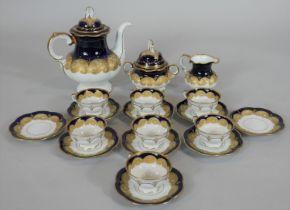 A Hutschenreuther porcelain coffee service to include coffee pot, sugar bowl, cream jug, seven