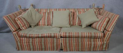 """A Knole sofa bed in candy stripe upholstery with 4'6"""" mattress. (Originally bought from Liberty)."""