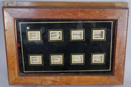 A late Victorian walnut cased eight division butler's bell call box. H.28cm