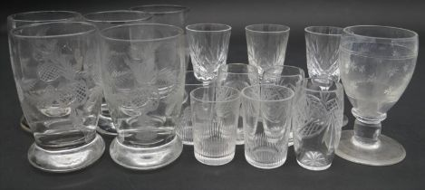 A collection of fifteen cut crystal glasses, including a set of four floral design brandy glasses,