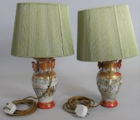 A pair of mid century table lamps and shades in the form of Japanese twin handled baluster form
