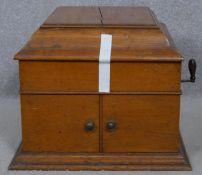 A C.1900 oak cased wind up gramophone. H.35 L.50 W.43.5cm