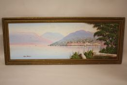 A GILT FRAMED OIL ON BOARD OF A HARBOUR SCENE AT SUNSET SIGNED PAOLO VANELLI, OVERALL SIZE INCLUDING