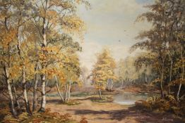 A FRAMED OIL ON BOARD OF A WOODED LANDSCAPE SIGNED J CURRIE LOWER RIGHT, OVERALL SIZE INC FRAME 73CM