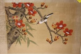 A FRAMED AND GLAZED ORIENTAL OIL ON SILK OF A BIRD ON A BRANCH