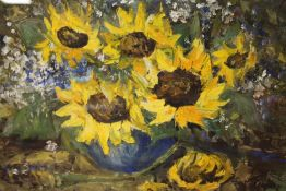 A FRAMED AND GLAZED OIL PAINTING OF SUNFLOWERS INDISTINCTLY SIGNED LOWER RIGHT, 49CM X 34CM