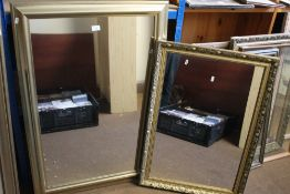A GILT FRAMED MIRROR TOGETHER WITH ANOTHER, THE LARGEST 105 X 75 CM (2)