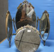 A CIRCULAR FRAMED FLORAL MIRROR TOGETHER WITH A DRESSING TABLE MIRROR