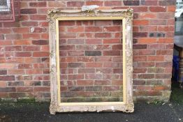 A 19TH CENTURY GOLD SWEPT FRAME WITH INTEGRAL SLIP A/F, frame W 10 cm, rebate approx 113 x 87 cm