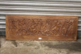A LARGE TRIBAL STYLE CARVED HARD WOOD PANEL, 102 X 36 CM