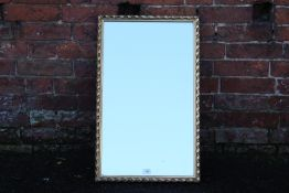 A GILT FRAMED WALL MIRROR, OVERALL SIZE 72 X 44 CM