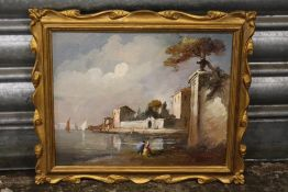 A SMALL GILT FRAMED CONTINENTAL OIL ON BOARD DEPICTING A COASTAL VILLAGE SCENE