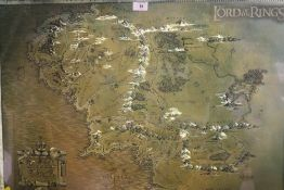 A FRAMED AND GLAZED LORD OF RINGS MAP OF MIDDLE EARTH TOGETHER WITH A PRINT