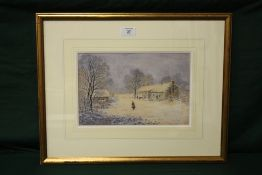 A FRAMED AND GLAZED WATERCOLOUR OF A FIGURE IN A COUNTRY LANDSCAPE WITH COTTAGES BY ROBERT MANN