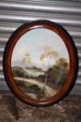 AN OVAL FRAMED AND GLAZED OIL ON BOARD DEPICTING A COUNTRY PATH - SIZE 51CM X 40CM