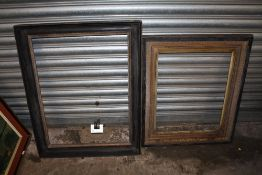 TWO GILT AND EBONISED WOODEN PICTURE FRAMES - LARGEST REBATE SIZE 65.5CM X 49CM - SMALLEST REBATE