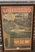A REPRODUCTION FRAMED AND GLAZED LONDON RAILWAY INTEREST PRINT ENTITLED 'UNDERGROUND WINTERS