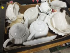 A TRAY OF MOSTLY PLAIN WHITE TEAPOTS TOGETHER WITH A TRAY OF GLASSWARE AND A SMALL TRAY OF METALWARE