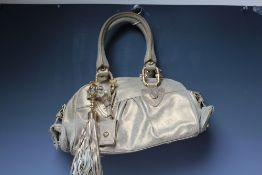 A JUST CAVALLI GOLD LEATHER HANDBAG, two loop handles, with gold-tone detail throughout, tasseled