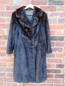 A VINTAGE RICH MAHOGANY BROWN MINK FUR COAT, fully lined, hook fasteners, front pockets, approx size