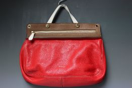 A FURLA SATCHEL STYLE HANDBAG WITH ADDITIONAL SHOULDER STRAP, red leather with cream and brown