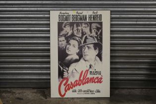A REPRODUCTION CASA BLANCA FILM ADVERTISING PRINT ON BOARD, 67 X 98 CM