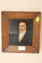 A SMALL PINE FRAMED OIL ON BOARD PORTRAIT STUDY OF A GENTLEMAN IN CLASSICAL DRESS A/F-BOARD SPLIT TO